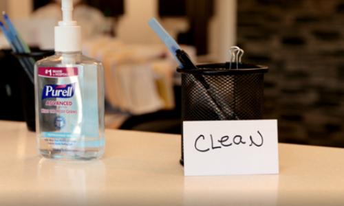 Hand Sanitizer and Pen Holder at dentistry